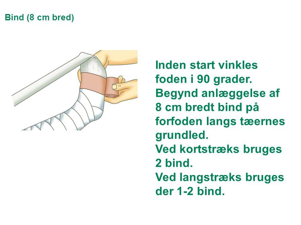 Bind (8 cm bred) Inden start vinkles foden i 90 grader. Begynd anlæggelse af 8 cm bredt bind på forfoden langs tæernes grundled. Ved kortstræks bruges