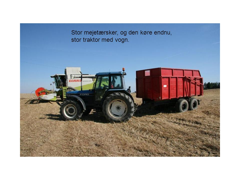 Stor mejetærsker, og den køre endnu, stor traktor med vogn.